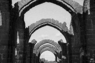 The arches of the Barakamaan, the half finished tomb, Bijapur in Karnataka, India. You can read more about Barakamaan here: https://amritpanigrahy.com/2017/06/28/dome-diaries-part-iii-two-and-a-half-tombs-and-other-things/